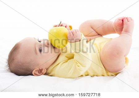 Sweet Baby Trying To Eat Apple yet no teeth Isolated On White Background
