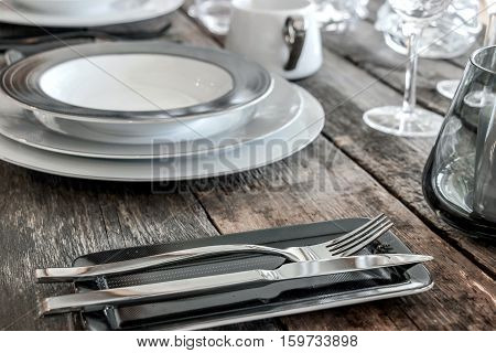 white and grey tableware on wooden table