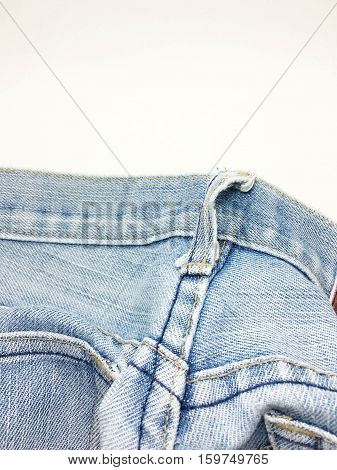The style and fabric of the jeans style. With buttons and zipper And lack of worn jeans.