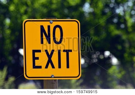 An image of a yellow no exit sign.
