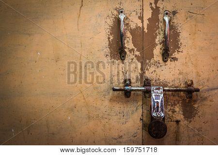 Locked antique doors in asia. Old lock of a wooden door in india.