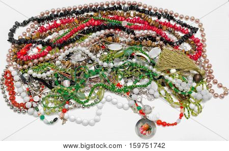 Closeup amazing view of various colorful jewelry and necklaces isolated on white background