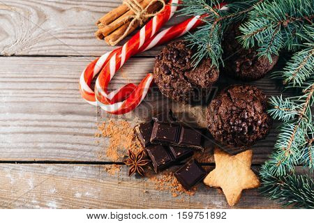 christmas chocolate cake on a wooden board with branches of spruce