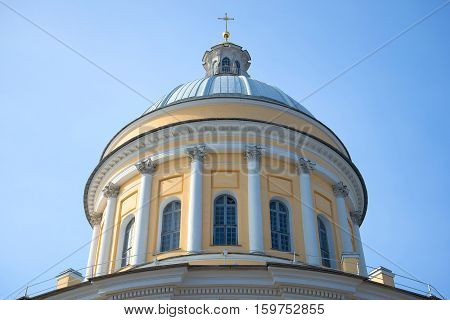 The old main dome of Trinity Cathedral of Alexander Nevsky Lavra close up against the background of the blue sky. St. Petersburg, Russia