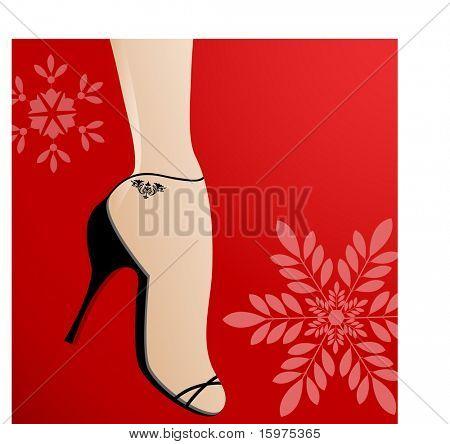 feminine foot with flowers behind