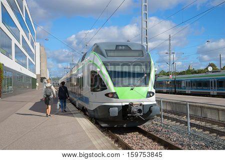 HELSINKI, FINLAND - AUGUST 28, 2016: Passengers coming to a standing train. Helsinki train station