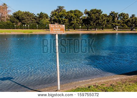 Sign at the model boat pond at Vacation Isle Park on Mission Bay in San Diego, California.