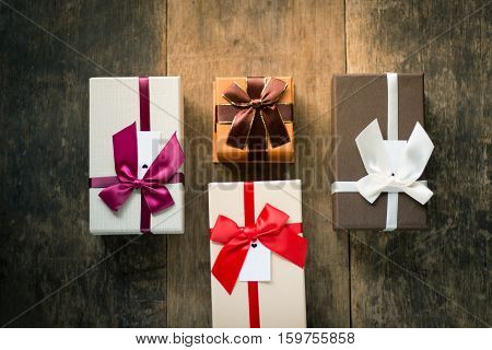 Four gift boxes on the wooden background