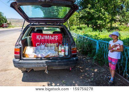 Girl Selling Kumis, Fermented Horse Milk
