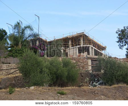 New building rising on hill in Spanish village