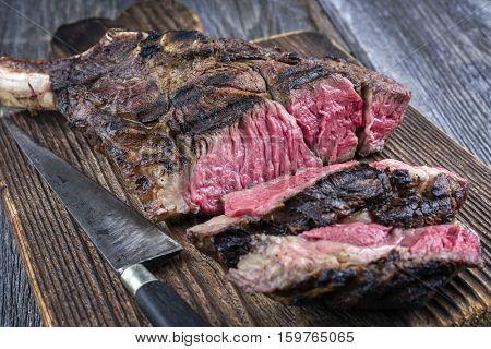 Barbecue Tomahawk Steak on Cutting Board
