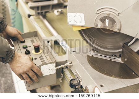 Worker Testing Circular Saw. Plastic Window And Door Industry Production.