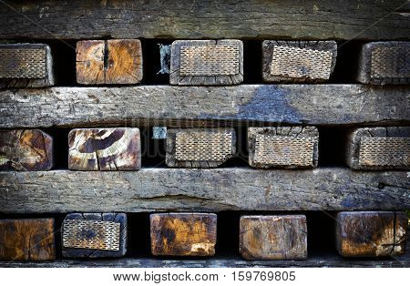 background or texture old stacked railway sleepers