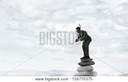 Businessman diving from top . Mixed media