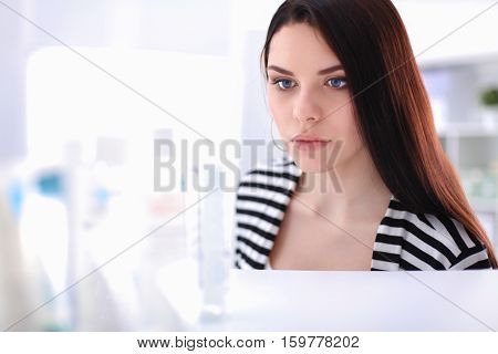 Portrait of beautiful young woman in shop