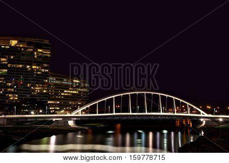 The Main Street Bridge in Columbus, Ohio glows at night