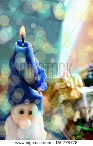 Santa Clause candle with giftboxes at Christmas time