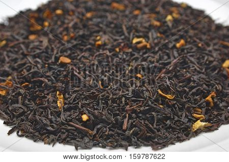 Dried tea leaves on plate, close-up