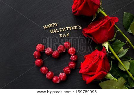 Happy Valentine's Day written on the board cherries in the form of heart