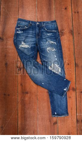 blue jeans isolated and wooden background