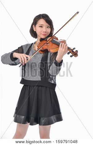 Asian young woman playing a violin isolated