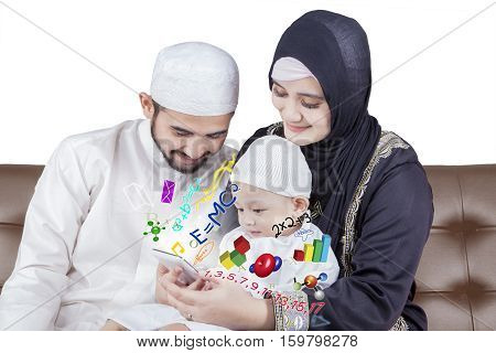 Arabian parents teaching math to boy by using a smartphone isolated on white background