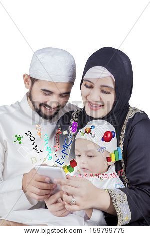 Portrait of cute boy learning math with his parents by using a smartphone isolated on white background