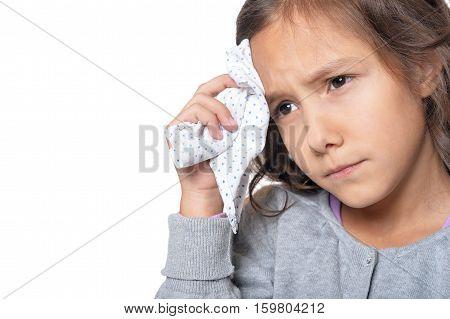 Portrait of sad little girl isolated on white background