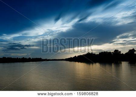 Beautiful sky in cloudy day at river, long exposure shot