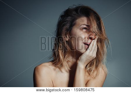 Lonely young woman depressed, sad and crying