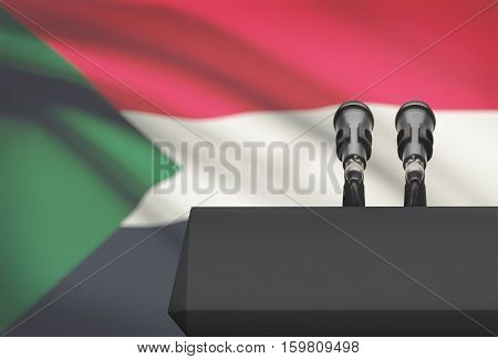 Pulpit And Two Microphones With A National Flag On Background - Sudan