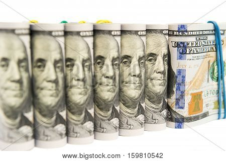 Packs of hundred dollar bills grouped together, isolated