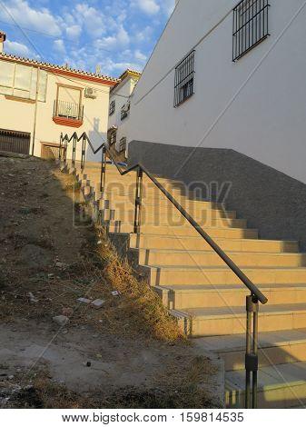 Ornate Railing And Steep Steps