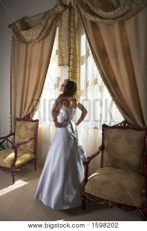 Beautiful Bride Next To Windows