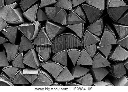 Stack of firewood. Close-up vintage monochrome shot
