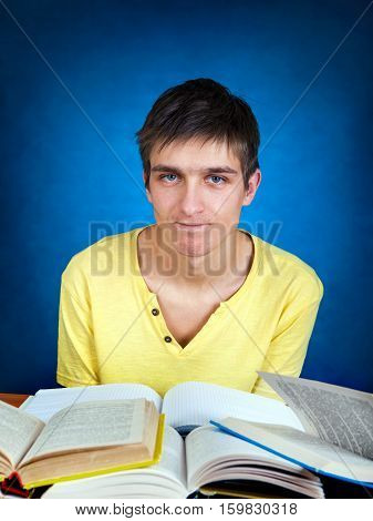 Annoyed Student with the Books on the School Desk