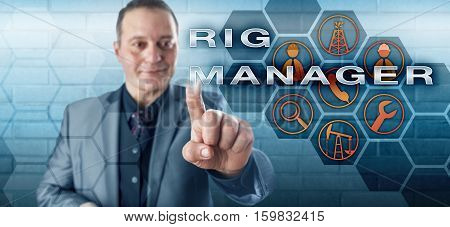 Happy male industrialist with toothless smile activating RIG MANAGER on a control screen. Oil and gas industry concept for a mid managerial role responsible for operations on a land drilling rig.