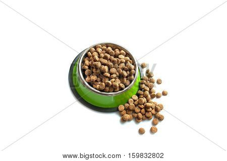 Dry dog food in a metal dog bowl green. Oval dog food croquettes. Isolate on white background.