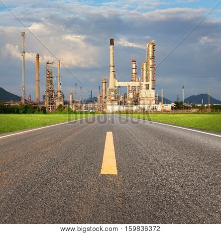 Oil refinery and asphalt road and blue sky background.