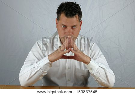 Young angry business man watching on isolated background