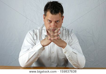 Young angry business man watching on isolated