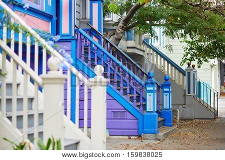 Colorful Porches Of Wooden Houses On Street Of San Francisco
