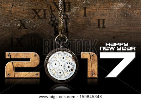 Happy New Year 2017 - Wooden numbers with an old and broken pocket watch with chain on a wooden background