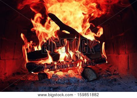 the texture of fire and flame tongues of fire in the furnace of a vintage red brick