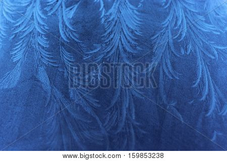 Amazing ice formation with detailed pattern in blue tones