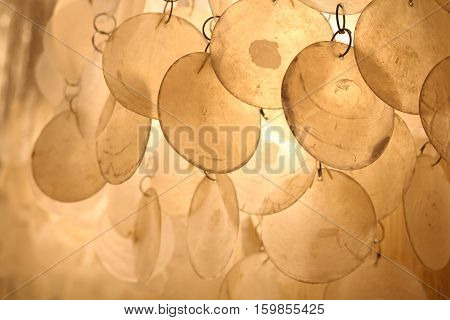 Lamp of circular plates of white mother of pearl