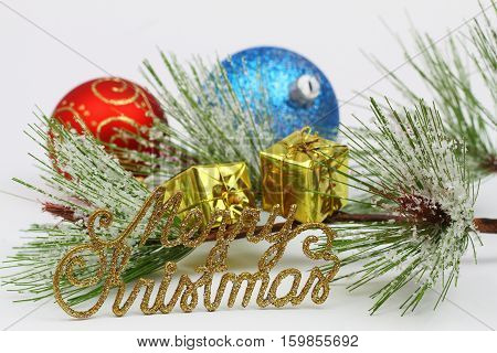 Merry Christmas written with golden letters, pine, Christmas presents and colorful baubles