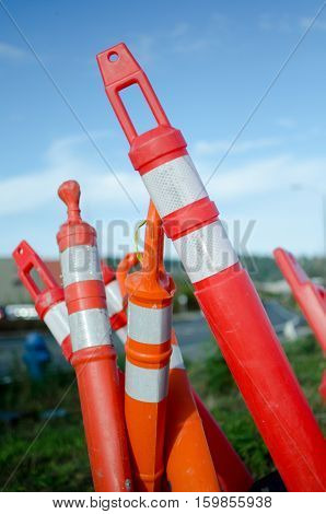 Forest of construction barrier red and white columns at building site
