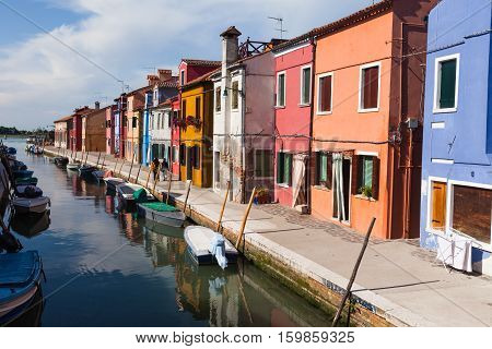 Colourfully painted houses on Burano. Burano is an island in the Venetian Lagoon, northern Italy. It is situated at the northern end of the Lagoon, and is known for brightly coloured homes.