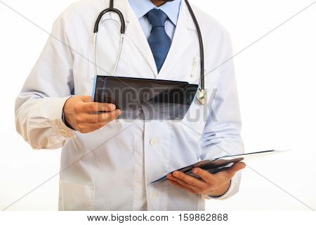 Doctor Holding A Mammography On White Background